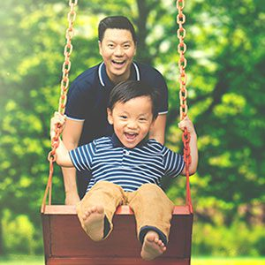 Dad and Son on Swing